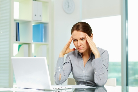 Business woman suffering from headache photo