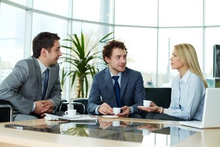 Business team sharing ideas during break photo