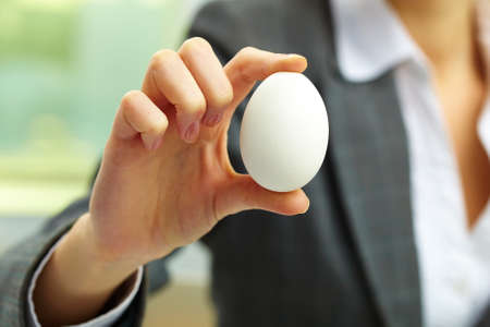 eternal life: Close-up of white egg in female hand Stock Photo