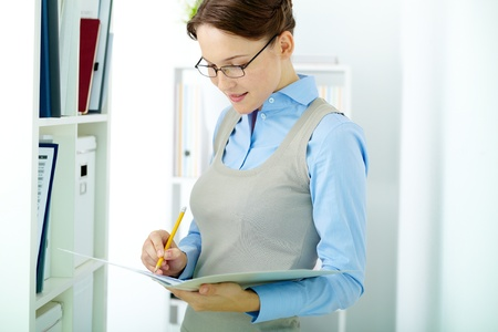 Portrait of elegant businesswoman working with papers in office Stock Photo - 14726861