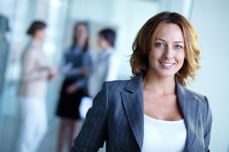 business leader: Image of pretty businesswoman looking at camera