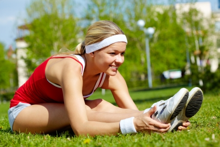 activewear: Portrait of a young woman doing physical exercise outdoors