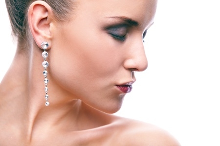 earring: Gorgeous woman with long earrings on white background Stock Photo