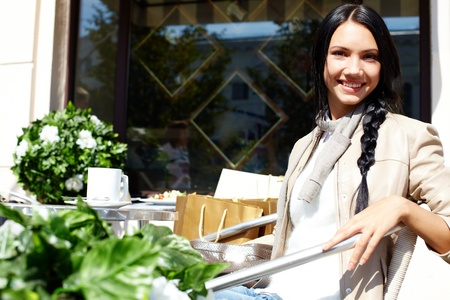 Image of happy female in open air cafe looking at camera in urban environment Stock Photo - 14798607