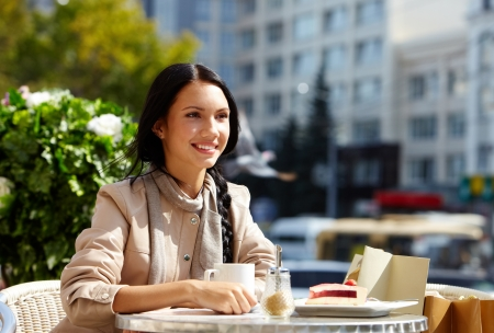 Image of happy female in open air cafe having coffee with cake in urban environment Stock Photo - 14798623