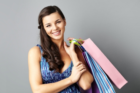 paperbags: Portrait of happy brunette with paperbags after shopping Stock Photo