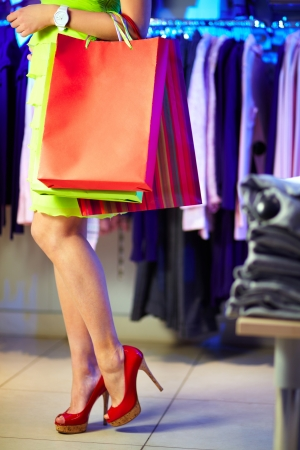 heeled: Image of shopaholic with shopping bags in clothing department