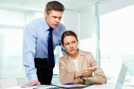 frowned: Business people looking worried about the financial results Stock Photo