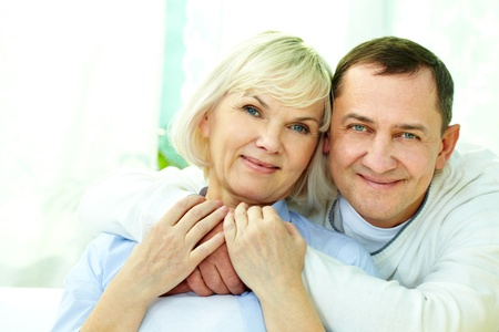 Portrait of attractive middle aged woman and man looking at camera  photo