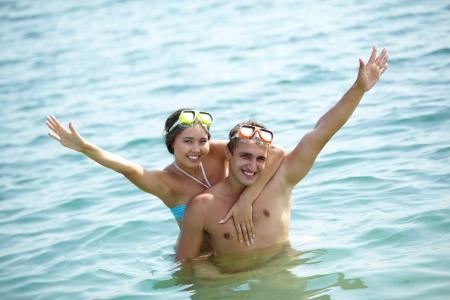 Friends in scuba masks having fun in water Stock Photo - 14843628