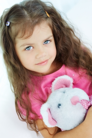 Portrait of lovely girl with teddybear looking at camera photo