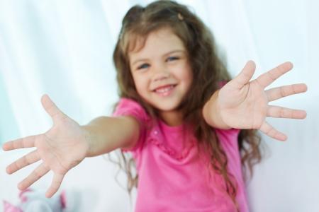 pretty little girl: Palms of lovely girl having fun Stock Photo