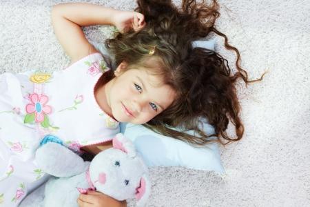 teddybear: Portrait of lovely girl lying with teddybear