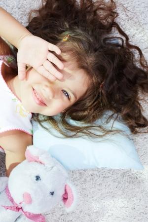 teddybear: Portrait of lovely girl with teddybear rubbing her eyes after sleep Stock Photo