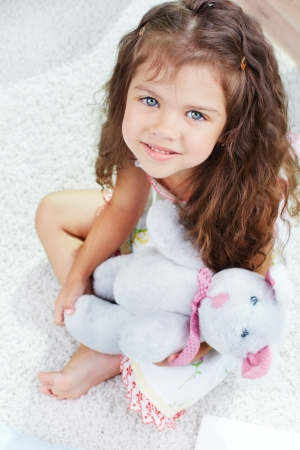 teddybear: Portrait of lovely girl with teddybear looking at camera