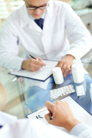 prescribing: Image of practitioners prescribing tablets