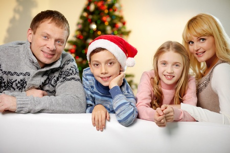 Portrait of four happy family members looking at camera with smiles Stock Photo - 15104272