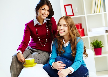 Portrait of young females looking at camera at home photo