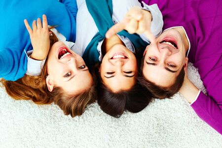 Above angle of ecstatic friends looking at camera Stock Photo - 15104285