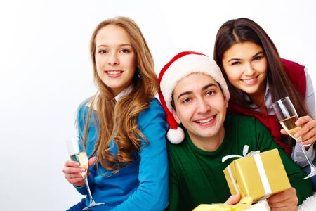Image of teenage friends with champagne and gifts looking at camera Stock Photo - 15104255