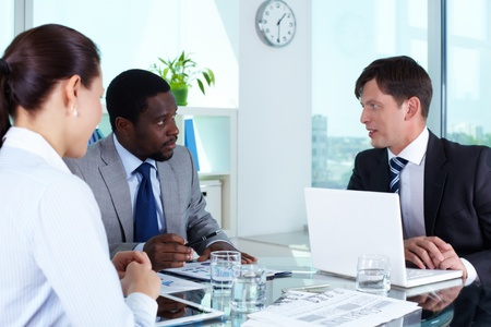 Portrait of business team discussing documents at meeting Stock Photo - 15104218