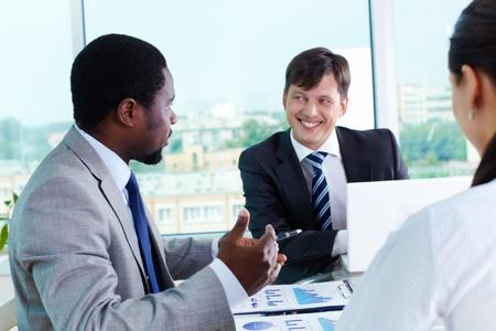 Two elegant businessmen communicating at meeting Stock Photo - 15104205