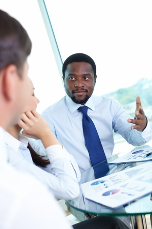 Portrait of serious boss talking to his employees at meeting Stock Photo - 15095978