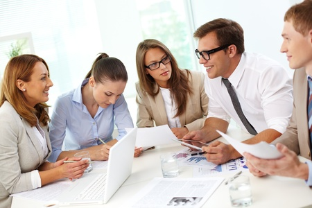 Image of confident partners sharing new ideas at meeting Stock Photo - 15104161