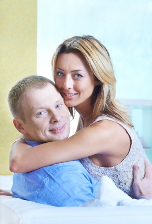 Pretty woman embracing with her husband and both looking at camera Stock Photo - 15297031