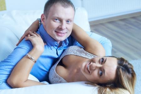 amorous woman: Amorous woman and man embracing and looking at camera Stock Photo