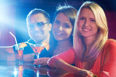 Portrait of happy friends having party in bar photo