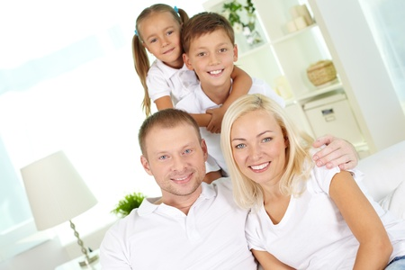 Portrait of happy family with two children looking at camera  Stock Photo - 15296941