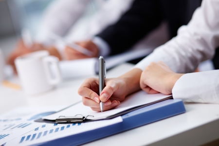 corporate training: Close-up of female hand making notes