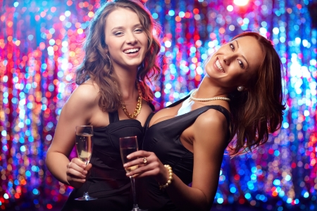 sexy girls party: Young women with champagne enjoying themselves at club Stock Photo