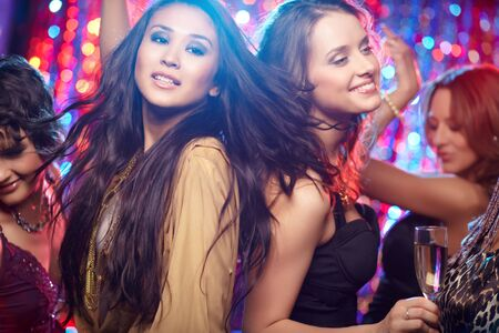 disco girls: Girls having fun at club tonight