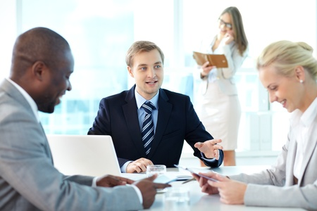 Portrait of confident boss explaining strategy to his partners at meeting Stock Photo - 15315841