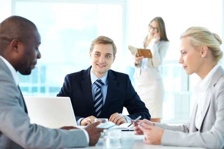Portrait of confident boss listening to his partners at meeting Stock Photo - 15315850
