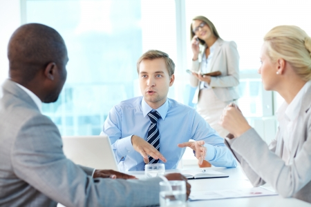 Portrait of confident boss explaining strategy to his partners at meeting Stock Photo - 15315873