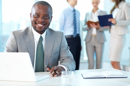 Portrait of happy boss looking at camera in working environment Stock Photo - 15315972