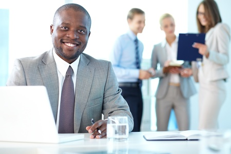 Portrait of happy boss looking at camera in working environment Stock Photo - 15315981