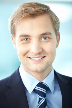 Portrait of cheerful businessman looking at camera photo
