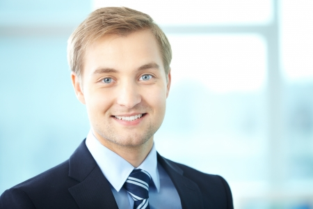 Portrait of cheerful businessman looking at camera Stock Photo - 15315884