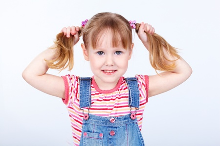 pigtails: Portrait of a sweet girl in a denim jumpsuit