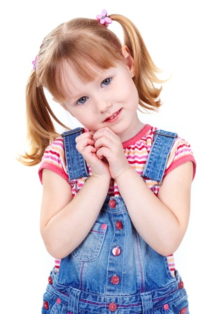 little girl smiling: Image of a sweet girl in a denim jumpsuit looking at camera