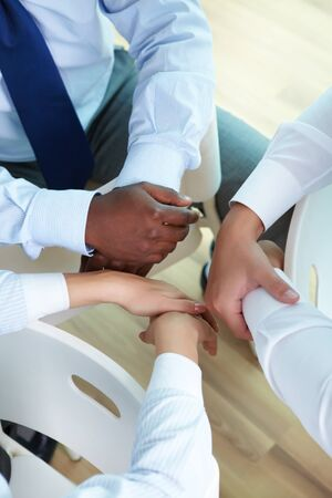 Hands of three businesspeople sitting in circle Stock Photo - 15513100