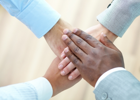 Above angle of pile of hands of business partners Stock Photo - 15436461