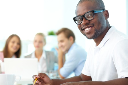 Portrait of happy African guy looking at camera with group of students behind Stock Photo - 15436034