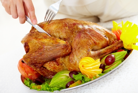 christmas turkey: Image of roasted turkey being cut by a human