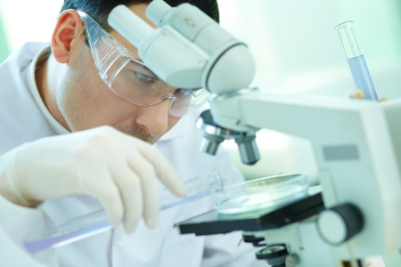 clinical laboratory: Serious clinician studying chemical element in laboratory