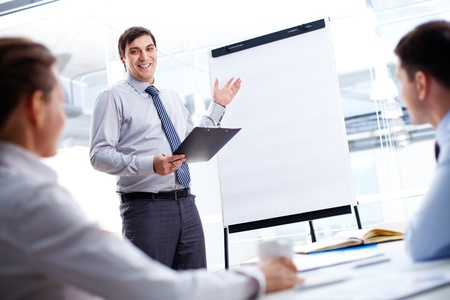 Confident businessman and his partners discussing something on a whiteboard Stock Photo - 15610962